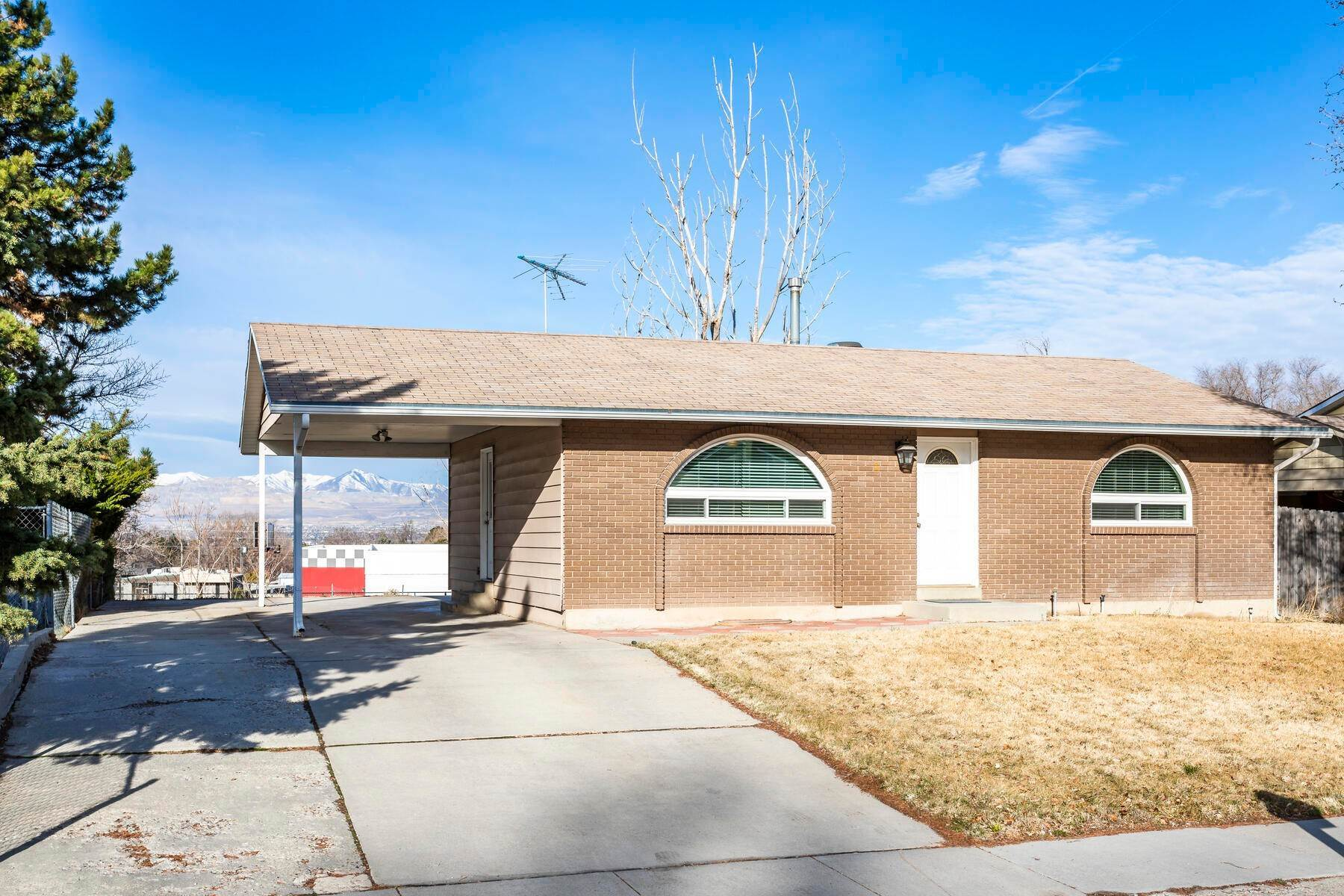 Single Family Homes for Sale at Spacious Sandy Rambler Now Available 10540 S Silver Mountain Drive Sandy, Utah 84094 United States